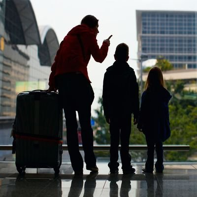 Family vs Business Travel - 5 Tips To Ditching Your Business Mindset And Enjoy Your Travel Time Off - The Wise Traveller - Family at Airport