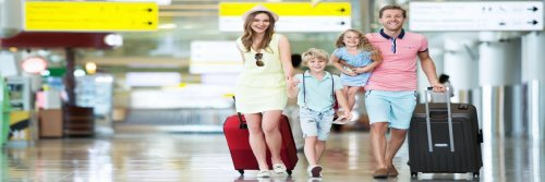 Family vs Business Travel - 5 Tips To Ditching Your Business Mindset And Enjoy Your Travel Time Off - The Wise Traveller - Happy Family at Airport