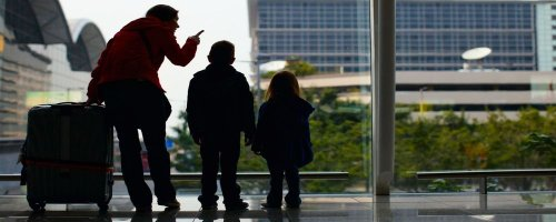 Surviving Taking the Kids on a Business Trip - The Wise Traveller - Family at airport