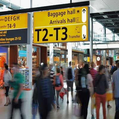 Worst Airports For Business Travellers - The Wise Traveller - Busy Airport Lobby