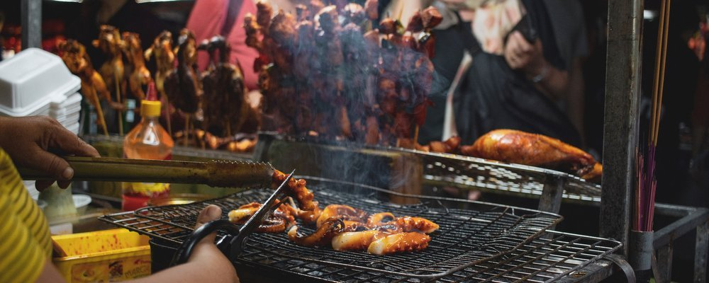 How to Avoid Getting Sick When Eating Local Foods - The Wise Traveller - BBQ
