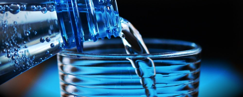 Reminders On Staying Healthy When Travelling - The Wise Traveller - Drinking Bottled water