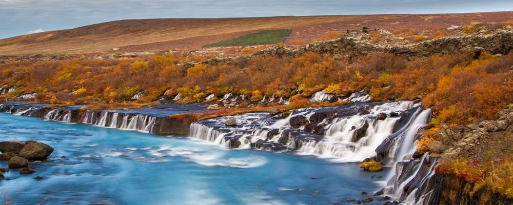 The Best Places to Visit for Fall Foliage - The Wise Traveller - Hraunfossar Waterfall - Iceland