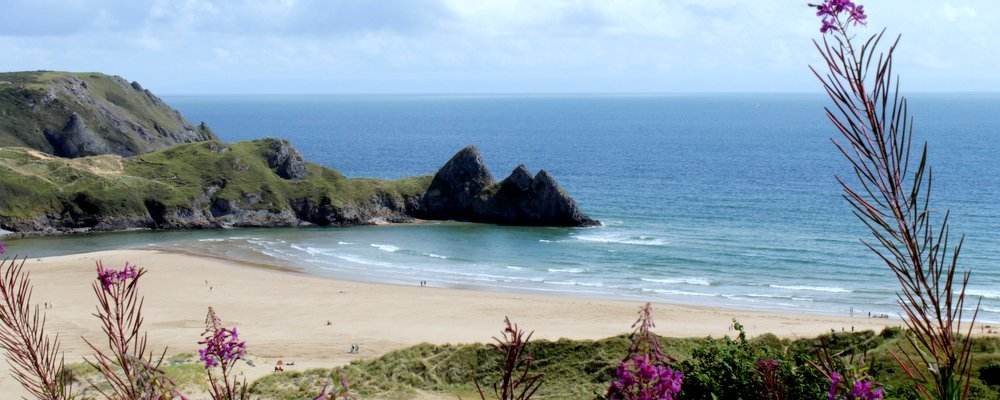Where to Find the U.K.'s Best Beaches - The Wise Traveller - Three Cliffs Bay